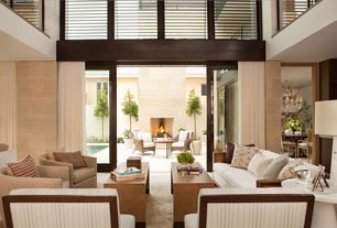 Contemporary Living Room with Cathedral ceiling, sandstone tile floors, interior wallpaper