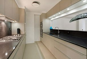 Modern Kitchen with double wall oven, full backsplash, stone tile floors, Undermount sink, Ceramic Tile, Soapstone counters