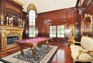 Craftsman Game Room with Casement, can lights, Hardwood floors, Standard height, stone fireplace, Fireplace, Wainscotting