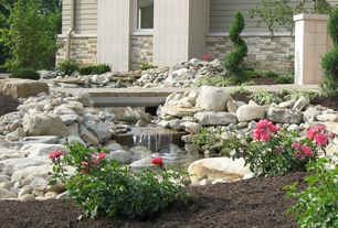 Traditional Landscape/Yard with Fountain, exterior stone floors, Pathway, Pond