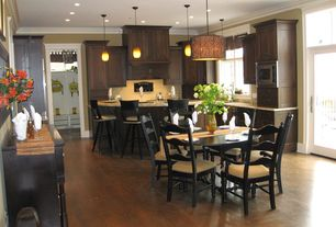 Modern Kitchen with Kitchen peninsula, Custom hood, Pendant light, L-shaped, French doors, Crown molding, Inset cabinets