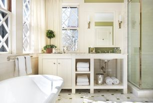 Traditional Master Bathroom with Simple marble counters, Undermount sink, Casement, framed showerdoor, Bathtub, Wall sconce