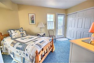 Traditional Guest Bedroom with French doors, Built-in bookshelf, Carpet