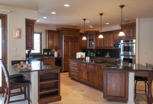 Traditional Kitchen with Glass panel, U-shaped, Kitchen island, French doors, Simple granite counters, limestone tile floors