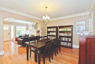 Traditional Dining Room with Crown molding, Hardwood floors, Standard height, Chandelier, Built-in bookshelf