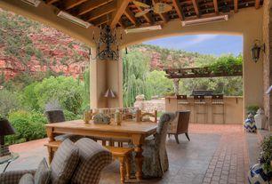 Mediterranean Porch with Wrap around porch, exterior stone floors, exterior brick floors, Trellis, Outdoor kitchen