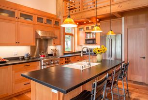 Craftsman Kitchen with Pendant light, specialty door, gas range, full backsplash, Flat panel cabinets, L-shaped, Flush, Loft