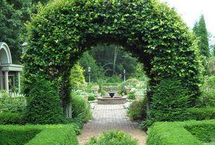 Traditional Landscape/Yard with Raised beds, Fence, Casement, Bird bath, Arbor, exterior stone floors