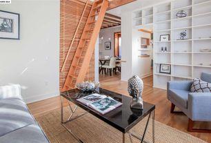 Contemporary Living Room with Hardwood floors, Built-in bookshelf, Standard height, Engineered hardwood flooring