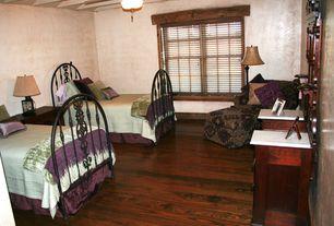 Rustic Guest Bedroom with Window seat, Exposed beam, Hardwood floors, Ceiling fan