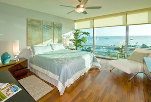 Contemporary Master Bedroom with Monarch specialties i 8074 accent chair, white faux leather, Oak flooring, Roller shades