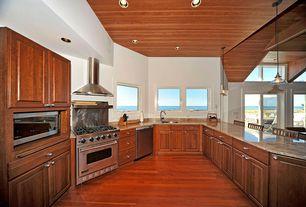 Craftsman Kitchen with Hardwood flooring, Pendant light, U-shaped, Undermount sink, Breakfast bar, Cabinet doors