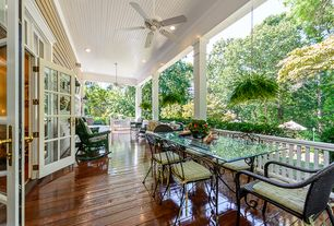 Traditional Porch with Wrap around porch, French doors, Savannah brown wicker rocker, Wrought Iron Table Base for Glass
