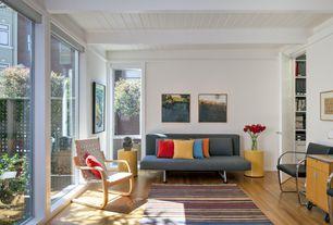 Contemporary Living Room with Laminate floors, Exposed beam, dCOR design aquios bentwood contemporary arm chair