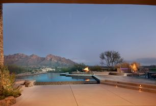 Contemporary Patio with Fountain, Infinity pool, Fence, Fire pit, exterior tile floors