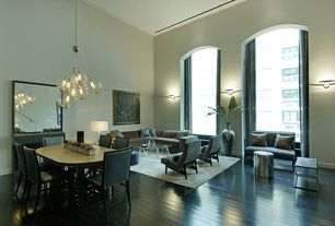 Contemporary Living Room with High ceiling, can lights, Wall sconce, Laminate floors, Arched window, Crown molding