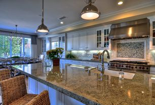 Traditional Kitchen with Kitchen island, Subway tile backsplash, White cabinets, Recessed lighting, Glass door, Crown molding