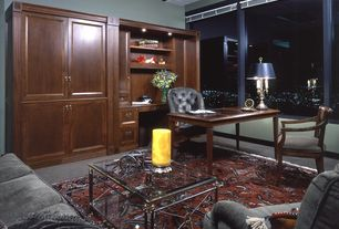 Traditional Home Office with can lights, Standard height, Built-in bookshelf, specialty window