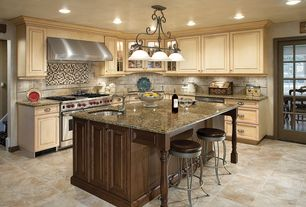 Traditional Kitchen with Raised panel, Kitchen island, limestone tile floors, L-shaped, Limestone Tile, Pendant light