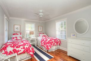 Traditional Guest Bedroom with Floral white round mirror, Twin bed, Ceiling fan, Floral bedding, Hardwood floors, Dresser