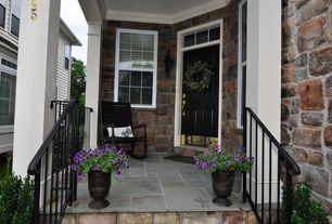 Traditional Porch with double-hung window, Wrap around porch, exterior stone floors, six panel door, Deck Railing