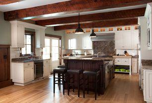 Craftsman Kitchen with Inset cabinets, Dual height countertop, Restoration hardware - harmon pendant - dark brass natural