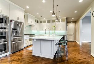 Modern Kitchen with warming oven, full backsplash, Pendant light, specialty door, Kitchen island, can lights, Flush, L-shaped