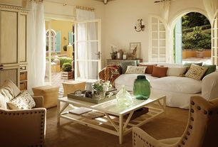 Eclectic Living Room with Wall sconce, Standard height, Carpet, Exposed beam, French doors, Arched window