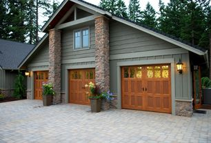 Country Garage with Glass panel door, Brick floors, Stone columns, Wall sconce