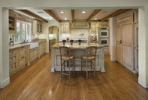 Country Kitchen with Exposed beam, Flush, Oak - Fawn 2 1/4 in. Solid Hardwood Strip, Stone Tile, Breakfast bar, Columns