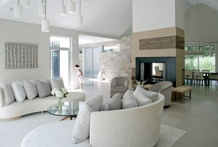 Contemporary Living Room with Polished porcelain floor and wall tile, stone fireplace, Glass panel door, Transom window