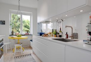 Contemporary Kitchen with Standard height, Corian counters, electric cooktop, Glass, Design within reach salt chair, Galley