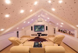 Modern Home Theater with Laminate floors, specialty door, Hardwood floors, Exposed beam, Low vaulted ceiling