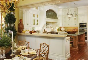 Traditional Kitchen with Custom hood, can lights, double wall oven, Pendant light, Casement, electric cooktop, U-shaped