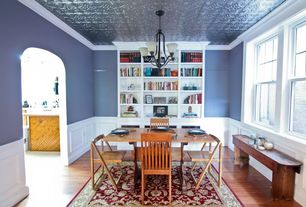 Traditional Dining Room with Surya MidtownRed Ivory Rug, Hardwood floors, Chandelier, Crown molding, Wainscotting