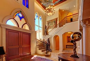 Mediterranean Entryway with High ceiling, Stained glass window, Columns, limestone floors, French doors, Chandelier, Balcony