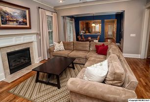 Traditional Living Room with Crown molding, stone fireplace, Hardwood floors