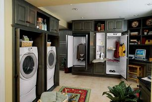 Craftsman Laundry Room with Built-in bookshelf, limestone tile floors, LG Styler Steam Closet, ASKO Drying Cabinet