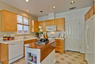 Craftsman Kitchen with picture window, stone tile floors, can lights, specialty door, Built-in bookshelf, Standard height