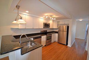 Traditional Kitchen with Quartz countertop, Flat panel cabinets, Flush, Pendant light, Undermount sink, flush light, U-shaped