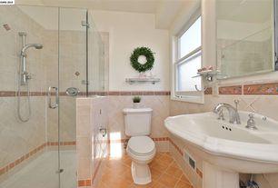 Traditional 3/4 Bathroom with Pedestal sink, limestone tile floors, Handheld showerhead, frameless showerdoor