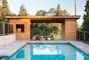 Contemporary Swimming Pool with exterior stone floors, Fence, Lap pool, Pathway