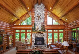 Rustic Living Room with Exposed logs, can lights, Standard height, French doors, Hardwood floors, Transom window, Fireplace