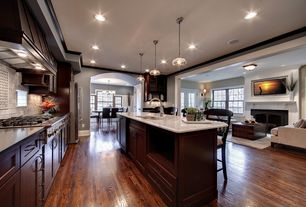 Traditional Kitchen with Standard height, Complex Marble Tile, can lights, Custom hood, Multiple Refrigerators, Flush