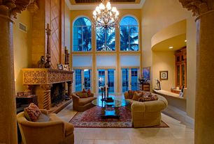 Mediterranean Living Room with Crown molding, High ceiling, French doors, Arched window, Concrete tile , Chandelier