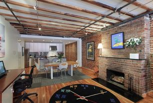 Modern Great Room with flat door, Hardwood floors, can lights, High ceiling, interior brick, Exposed beam, Fireplace