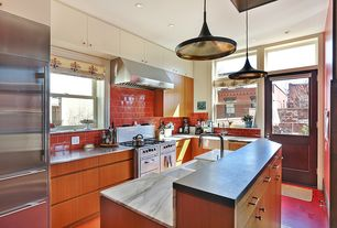 Modern Kitchen with Complex marble counters, Marble.com absolute black flamed granite, Farmhouse sink, Glass panel door