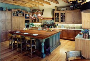 Country Kitchen with U-shaped, Custom Size Mahogany Butcher Block - Prefinished, Stone Tile, Kitchen island, Chandelier