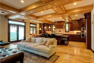Craftsman Great Room with Built-in bookshelf, Hardwood floors, Transom window, Pendant light, Box ceiling, Crown molding