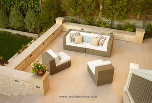 Contemporary Patio with exterior stone floors, Raised beds
